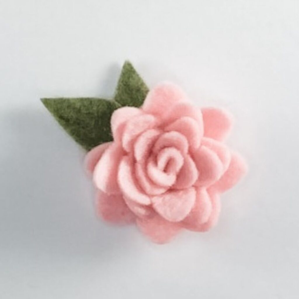 pink and green rolled felt rose and leaves